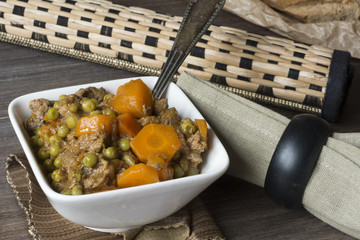 veal stew on wooden background