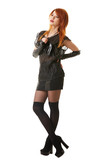Charming red-haired model posing in gothic clothes poster