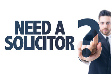 Business man pointing the text: Need a Solicitor?