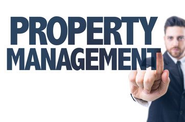 Business man pointing the text: Property Management