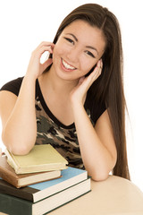 Cute teen model sitting with school books smiling