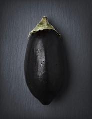 Whole eggplant isolated on stone.