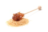 Brown sugar crystal on wooden stick