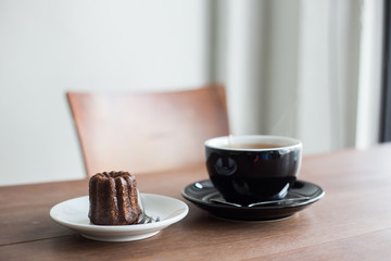 brown sweet canele and hot tea