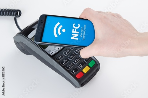 Leinwanddruck Bild Mobile payment with NFC near field communication technology
