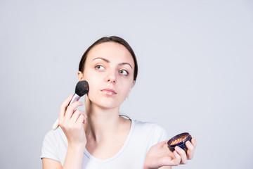 Vain Girl Applying Foundation Makeup on her Face