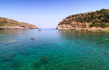 Crystal clear waters in a turquoise bay in Rhodes