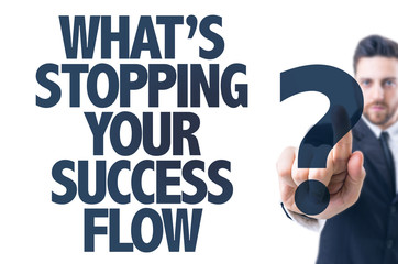Business man pointing: Whats Stopping Your Success Flow?