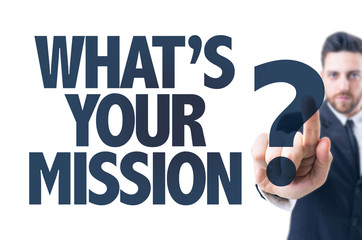 Business man pointing the text: Whats Your Mission?