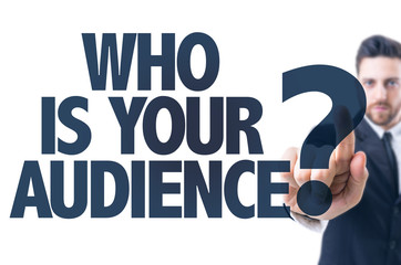 Business man pointing the text: Who Is Your Audience?