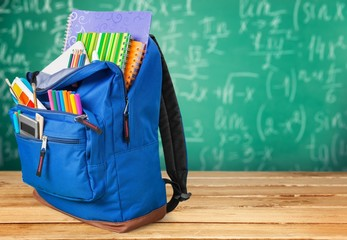School. Backpack with school supplies including, notebooks, pens