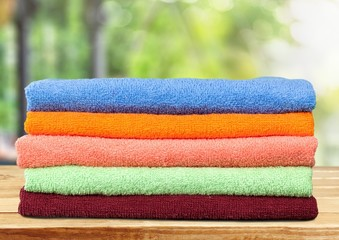 Towel. Five stacked, multicolored bath towels isolated on white