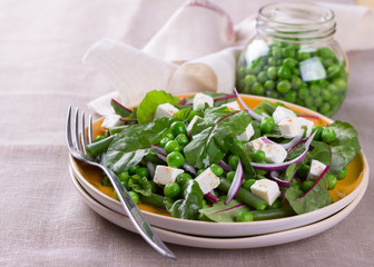 Salad with green peas, beans, red onion and feta cheese