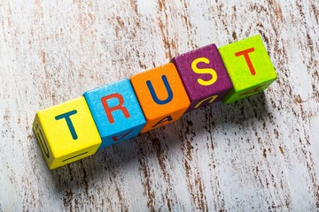 Trust. Concept of trust word on wooden cubes