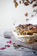 onions savoury cake on wooden cutting board with autumnal leaves - 81316401