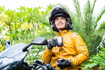 Asian man on motorcycle with helmet