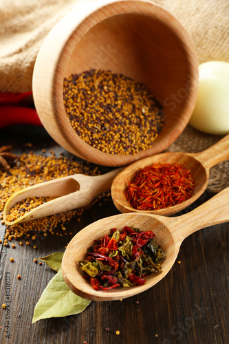 Fotobehang Kruiden 2 Different kinds of spices on wooden background