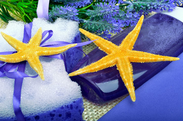 Lavender flowers with liquid soap, bathroom accessories, starfis