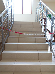 Entrance stairs closed with rope, no entry sign.