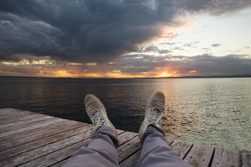 relax on the pier at sunset