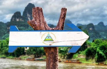 Nicaragua Flag wooden sign with nature landscape