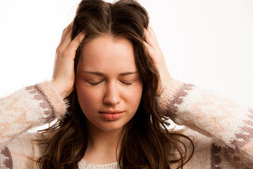 Asian caucasian woman having a head ache - girl with pain in hea