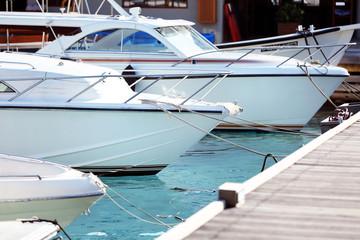 Yacht berth in ocean water in resort