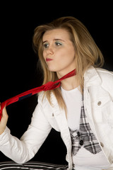 Young female caucasian model pulling on a men's red tie
