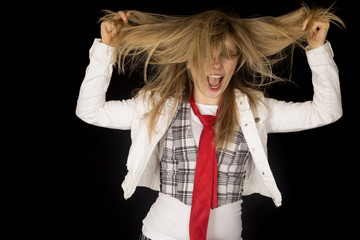 Crazy caucasian young female excited pulling her hair