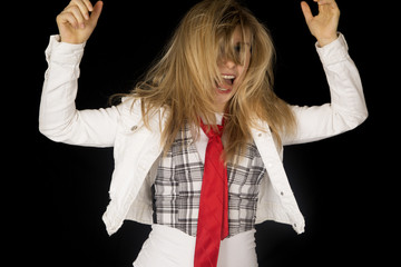 Excited blond female model with messy hair and hands up