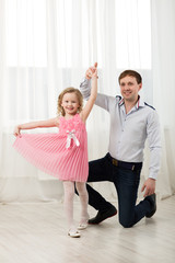 Little princess dancing with father