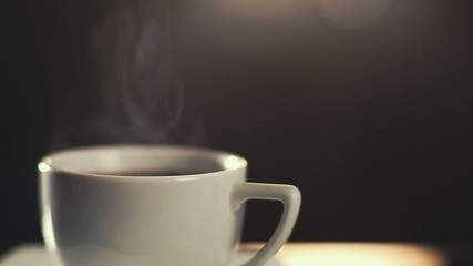 HD video of classic coffee cup with steam rising