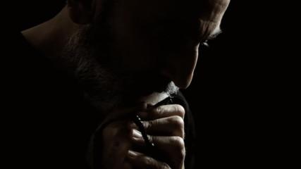 Religious man praying crisis