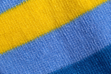 Surface of colorful fabric socks in macro style.