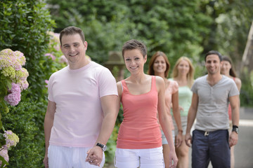 Group of people with couples walking outdoors
