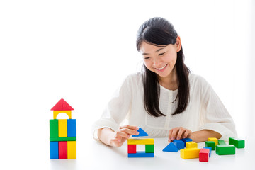 young asian woman playing building block