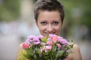 Happy woman holding boquet