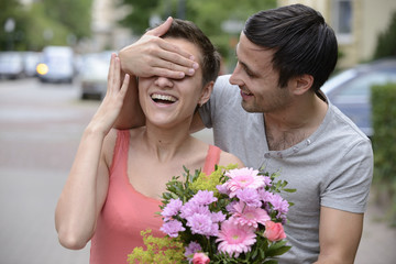 Surprise with bouquet of flowers