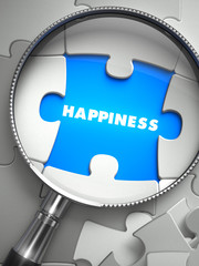 Happiness - Missing Puzzle Piece through Magnifier.