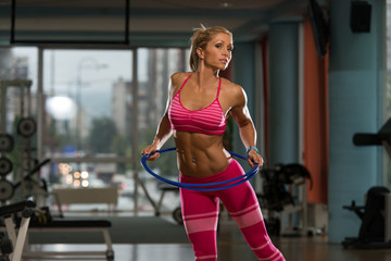 Attractive Woman Rotates Hula Hoop