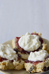 Sultana Scones with Jam and Cream on Plate with Copy space