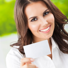 Businesswoman showing blank businesscard