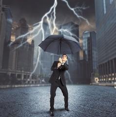 Businessman against lightning