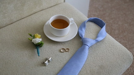 Wedding rings and boutonniere, shallow depth of field