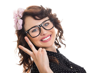 Cheerful happy young woman showing her two fingers at peac