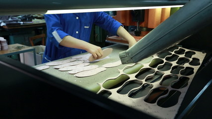 View of worker takes manufactured insoles
