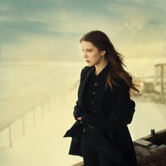 beautiful girl in a black coat. photo Gothic