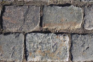 Старая брусчатка на дороге текстура
