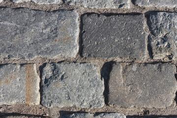 Каменная брусчатка на дороге текстура