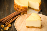 Cheesecake (New York cheesecake) on wooden background